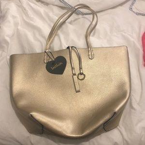 Metallic gold handbag